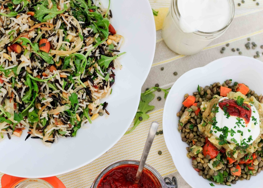 rice salad with nuts and sour cherries and lentils with charred eggplant and harissa