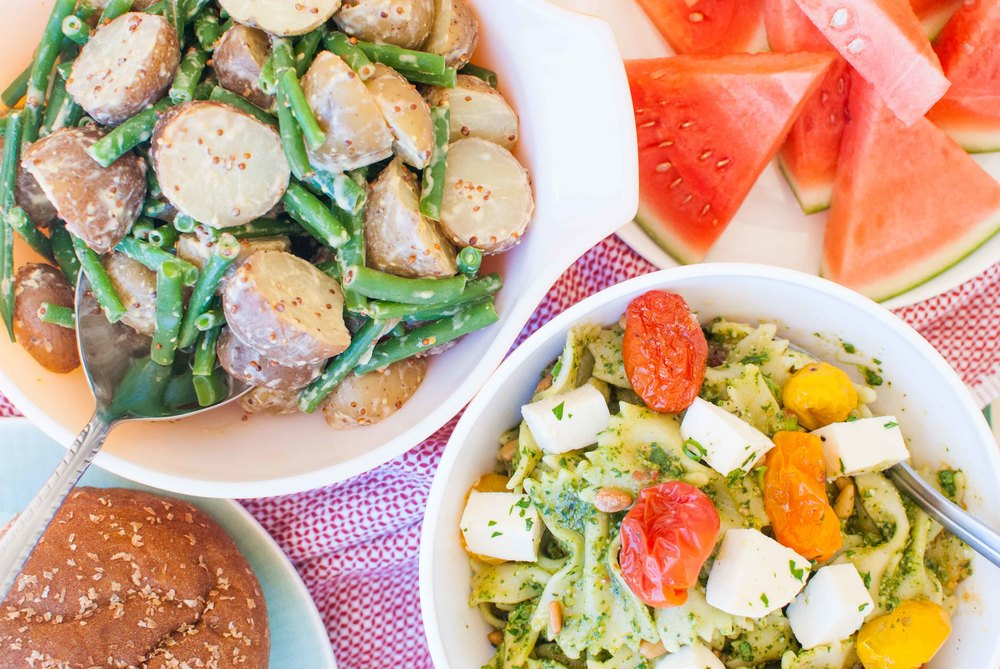 mustardy potato salad and pesto pasta salad with roasted tomatoes