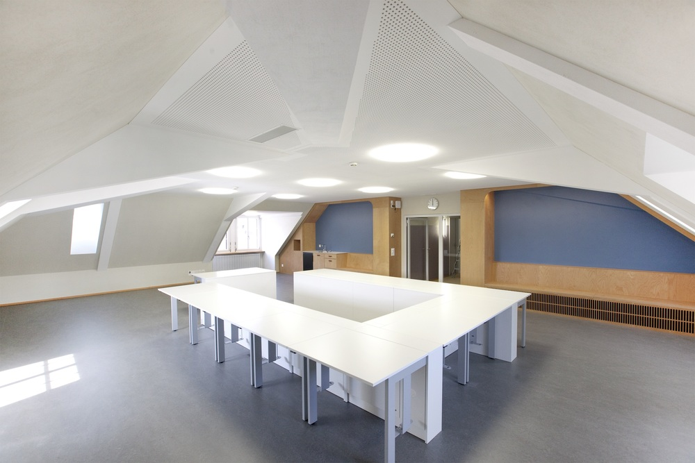 Psychiatric Clinic, Winterthur, ARBA Bioplan         SEA VIEW    Different white colours on daylight and shadow walls contour the architecture of this meeting room. Interesting elements within the ceiling become visible. The water blue colour, used in the relaxation room, implies an open sea view while lying in a sandy beach. A mango coloured clay wall in the doctor's office adds an natural heterogenous surface to the renovation of this attic floor. Every wall is painted in sustainable silicate colour by the colour system of BEECK.      Click here!