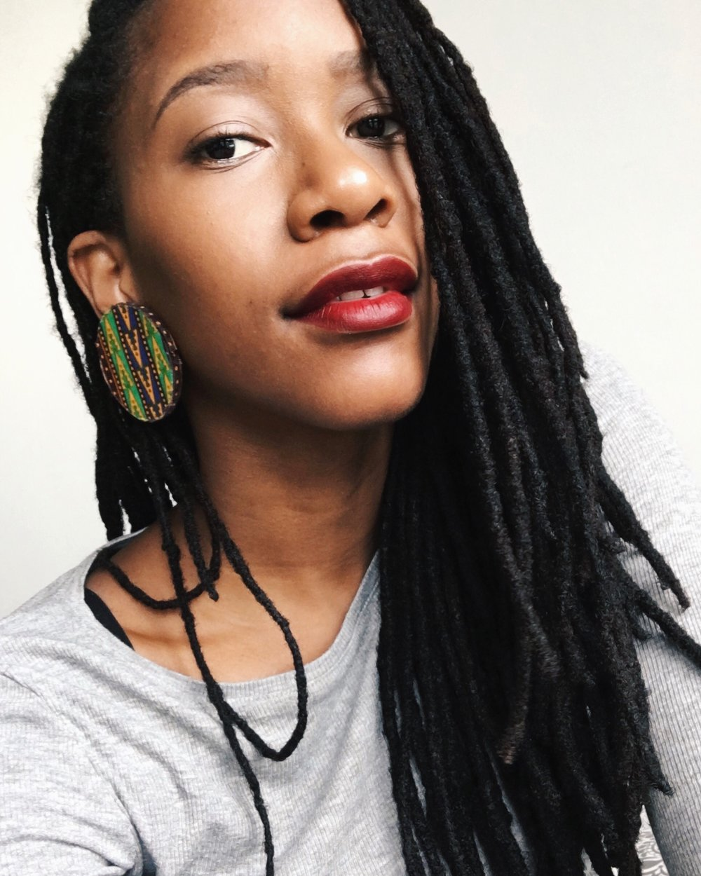 Five years on, long locs and big earrings in Singapore!