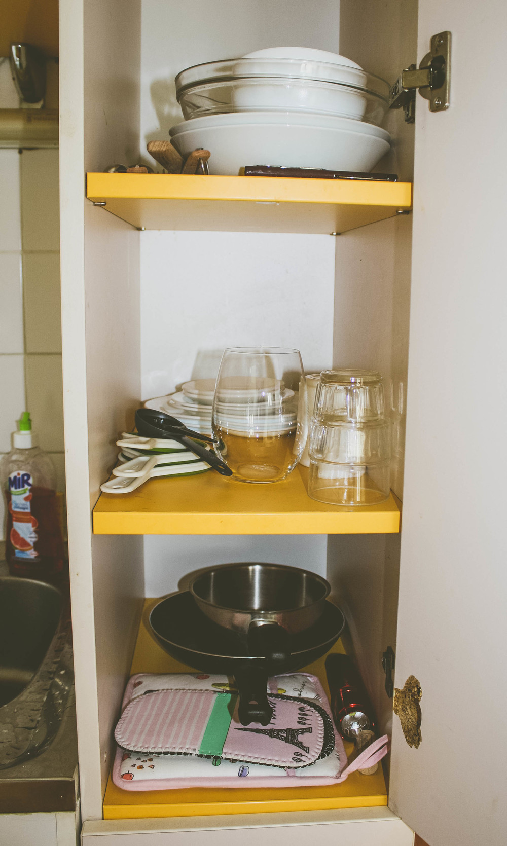 First Apartment in Paris: the cupboard where our dishes go.