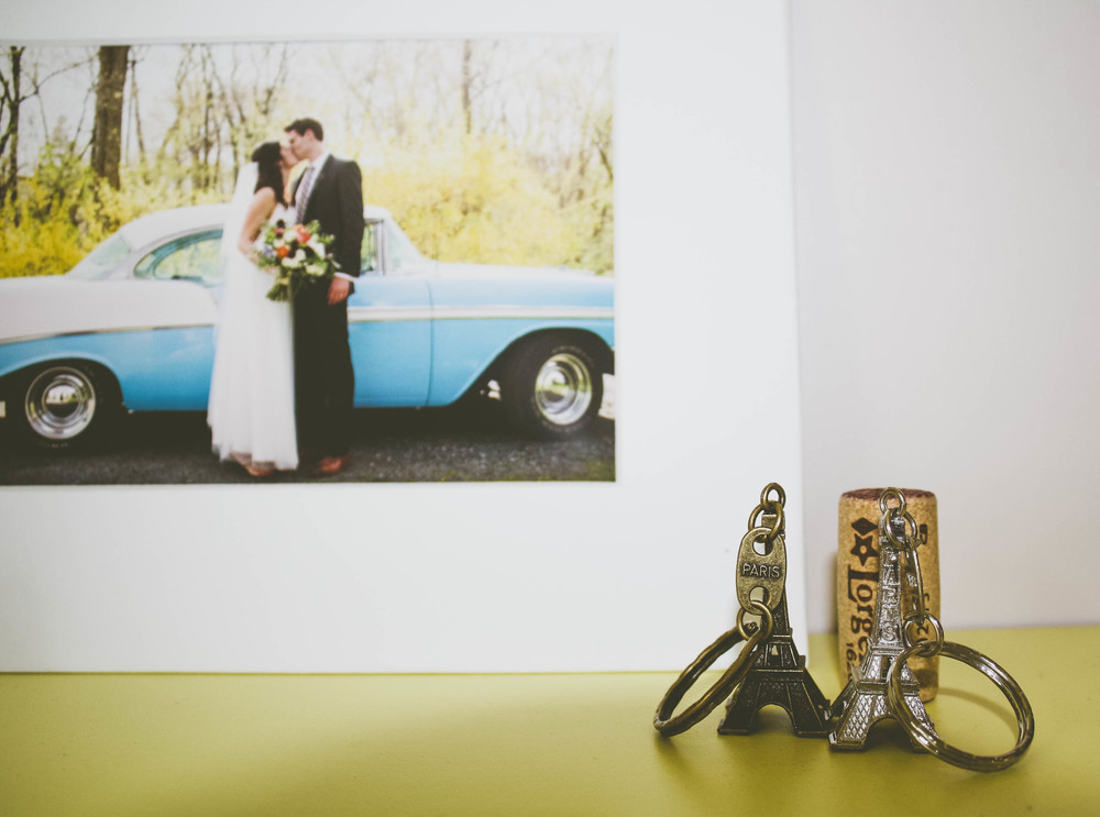 First Apartment in Paris: Eiffel Tower keychains and a wedding picture.