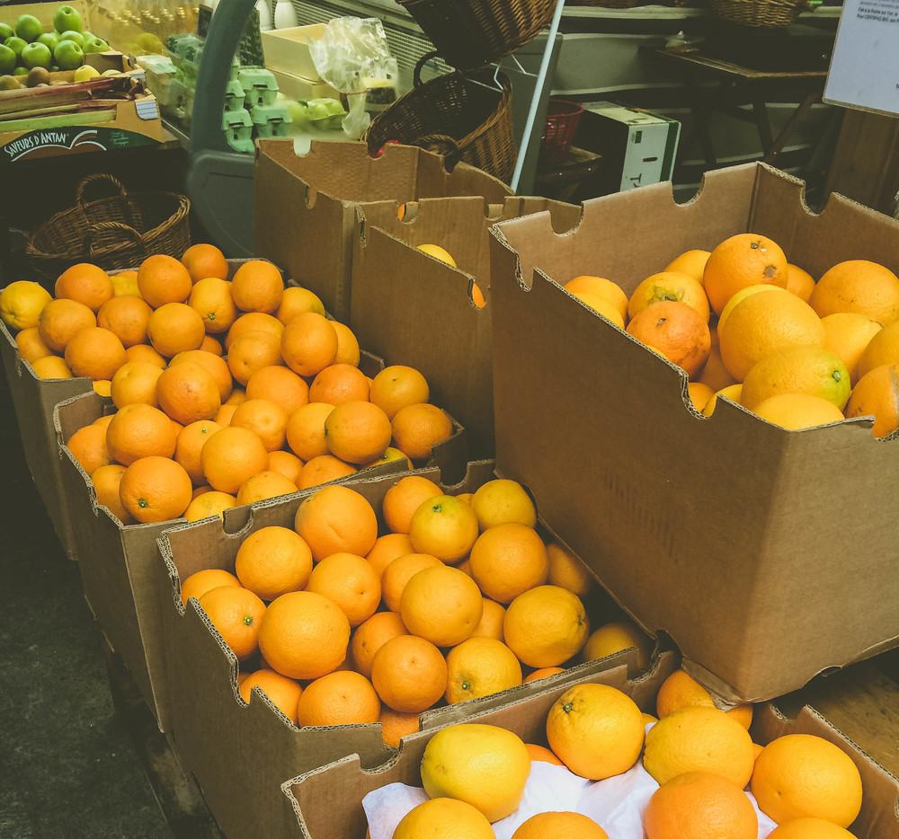 Oranges at the market. Possibly for orange juice.