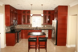 cherry kitchen and tiled backsplash.jpeg