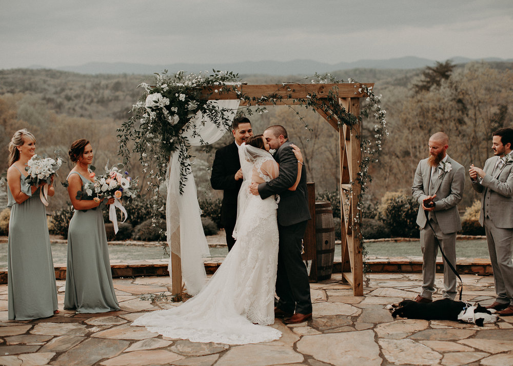 52 - Bride and groom's kiss on wedding day .jpg
