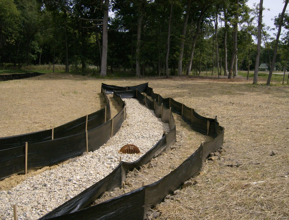 Silt fence and mulch in infiltration basin during construction.