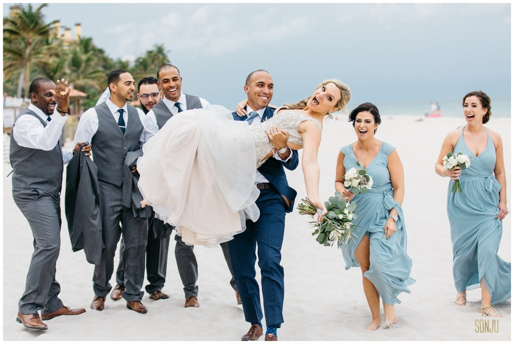 Wedding party on the beach at the Pelican Grand Resort Fort Lauderdale Florida