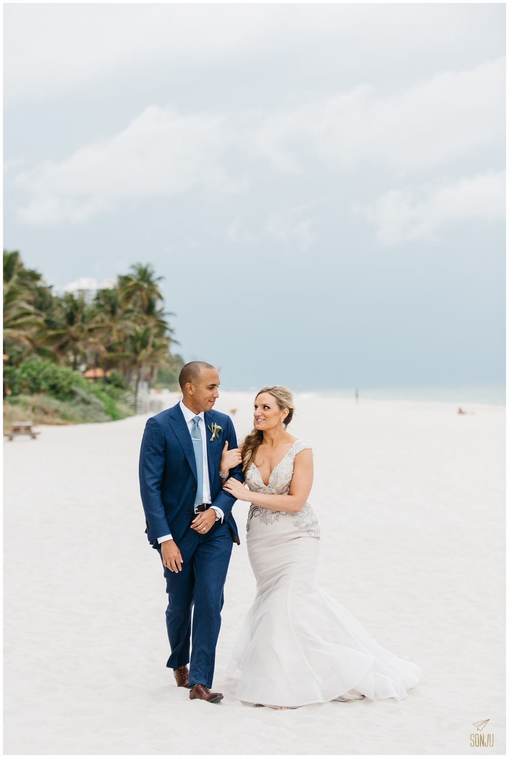 Bride and groom beach portraits at the Pelican Grand Resort Fort Lauderdale Florida