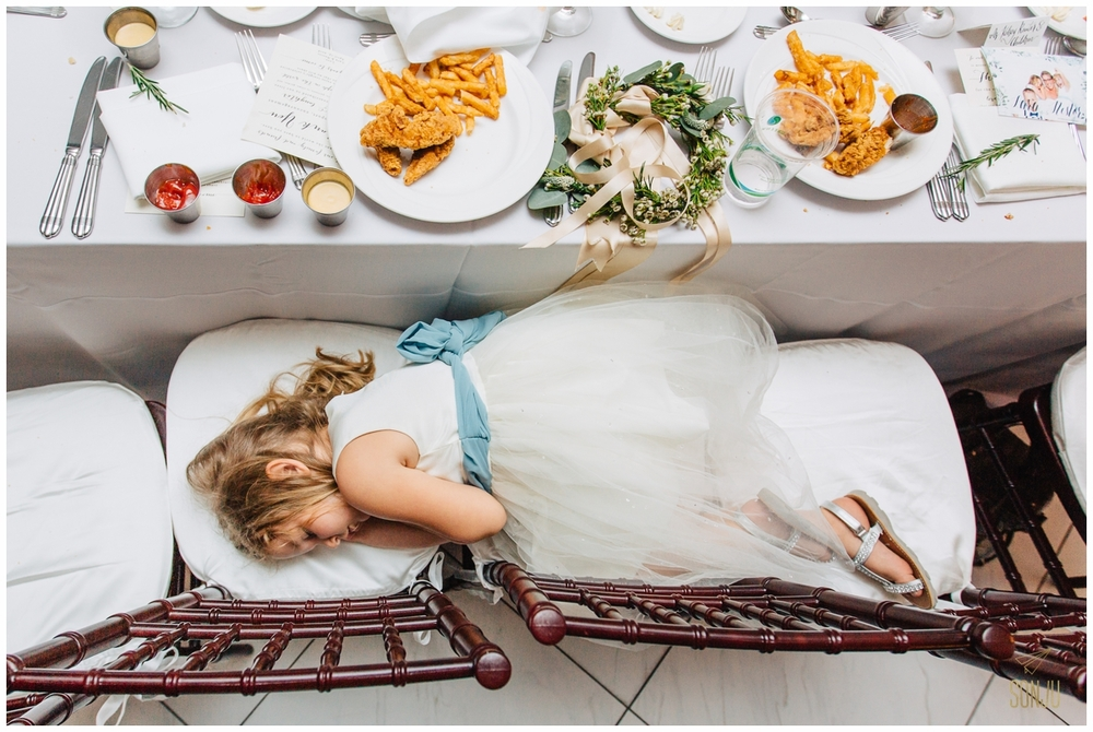 Flower girl asleep at Pelican Grand Resort Fort Lauderdale Florida wedding