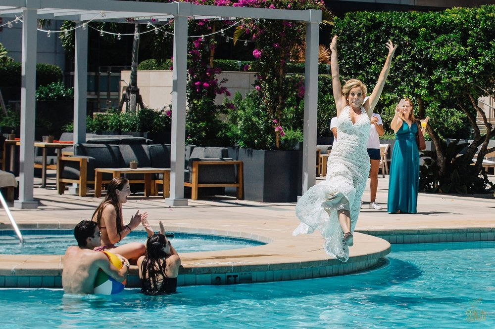 Bride jumps in pool at Four Seasons Miami