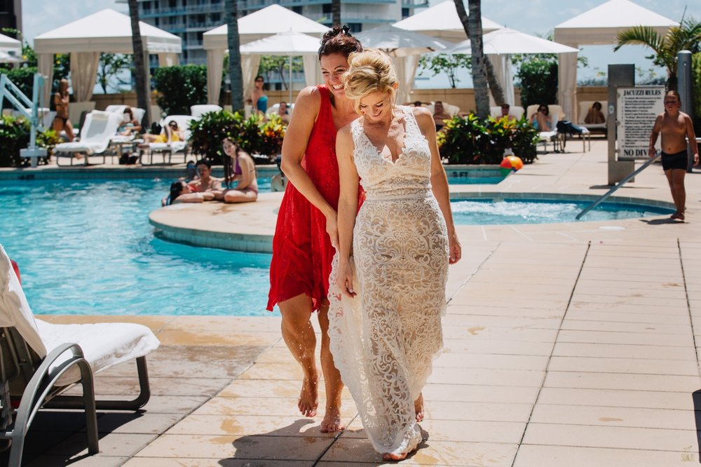 Bride in pool at Four Seasons Miami Brickell Wedding