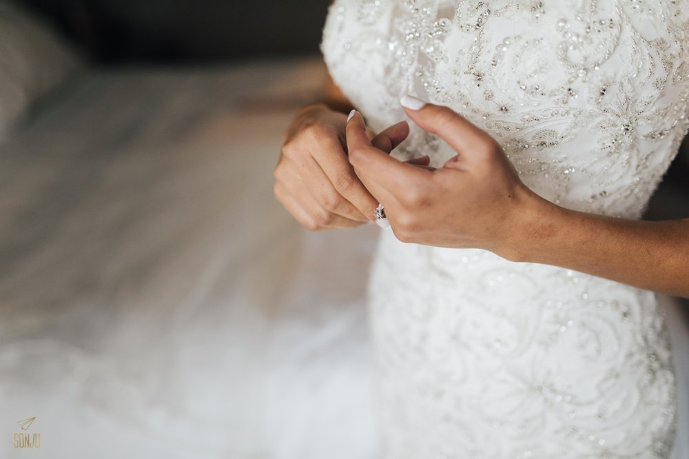 Bride's nervous hands while getting ready