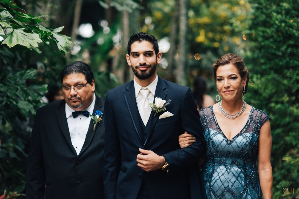 Parents walk groom down the aisle