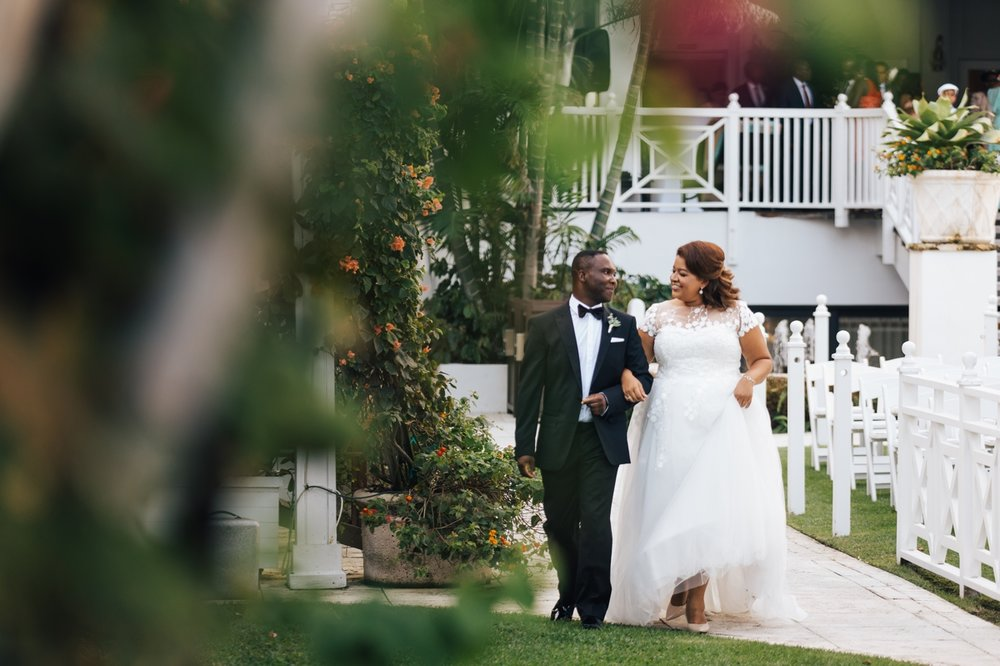 Bride and Groom take a stroll in the gardens at the Palms Hotel & Spa
