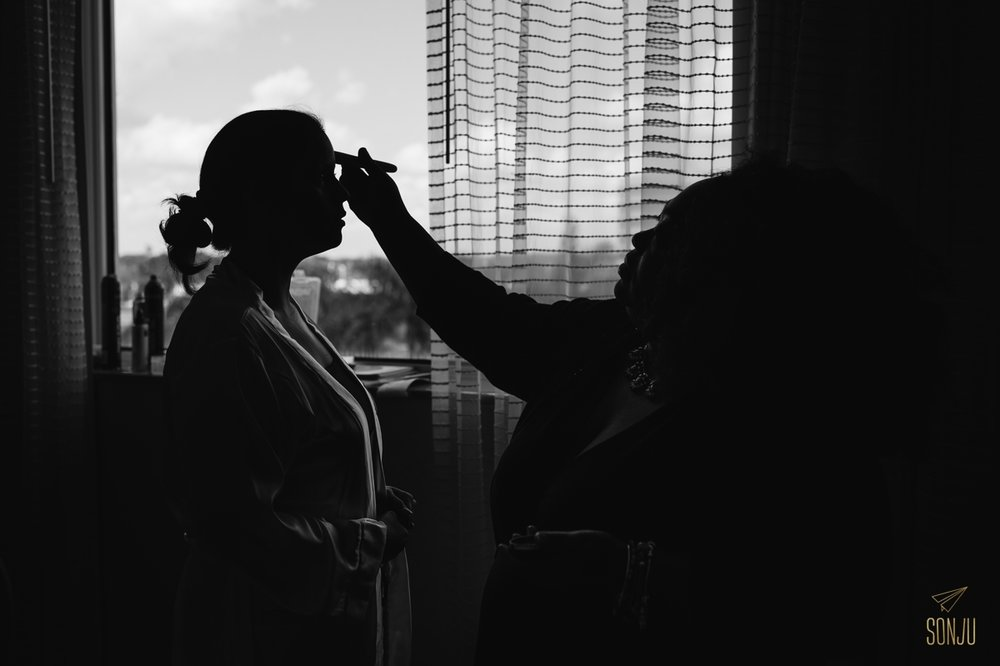 South Florida Makeup Artist Toshi applying makeup to bride