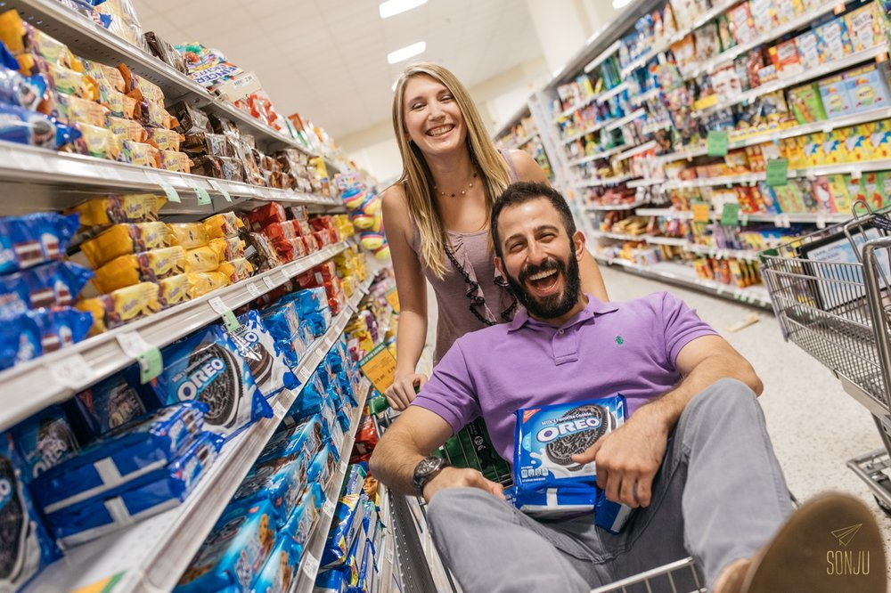 Woman pushes future husband in shopping cart down the aisle in Publix