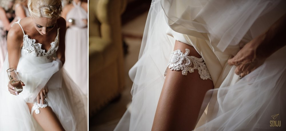 Bride places garter at the Boca Raton Resort before her wedding ceremony