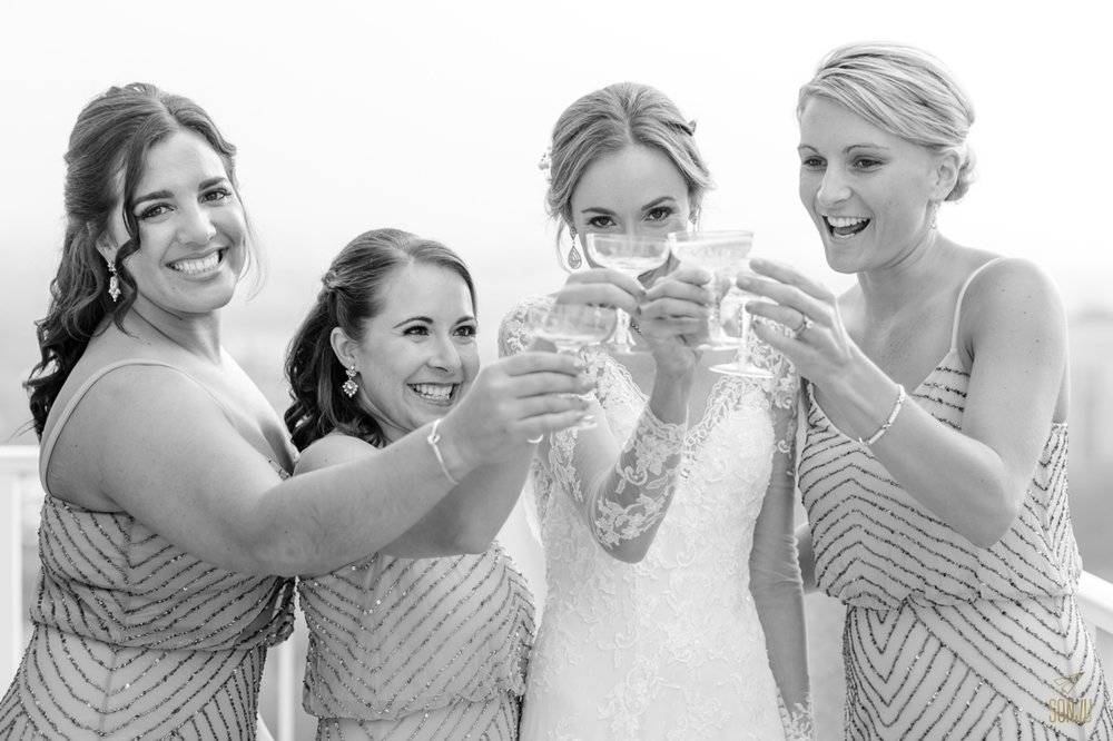 Bride and bridesmaids have a sip of champagne before the wedding ceremony at Stranahan House in Ft Lauderdale