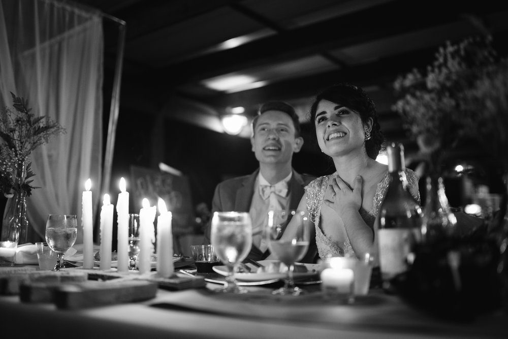Bride and Groom react to a slideshow made by their friends at their intimate backyard wedding in Miami Florida