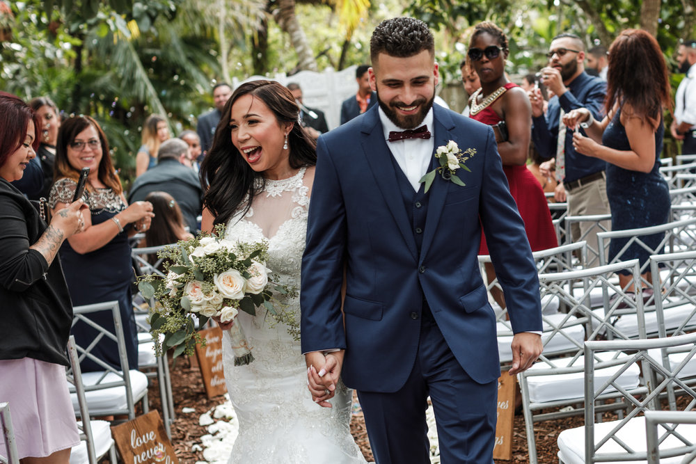 Bride and groom recessional up the aisle after their ceremony at the Old Grove in Miami, Florida, Miami wedding photographer, south florida wedding photographer, miami wedding photographers, rustic wedding photographer