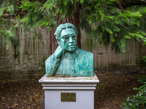 Statue of Sir Dr. Jagadish Chandra Bose at Christ's College, University of Cambridge, England. He was a Bengali polymath, physicist, biologist, botanist, archaeologist. Photo credit: e X p o s e / Shutterstock.com