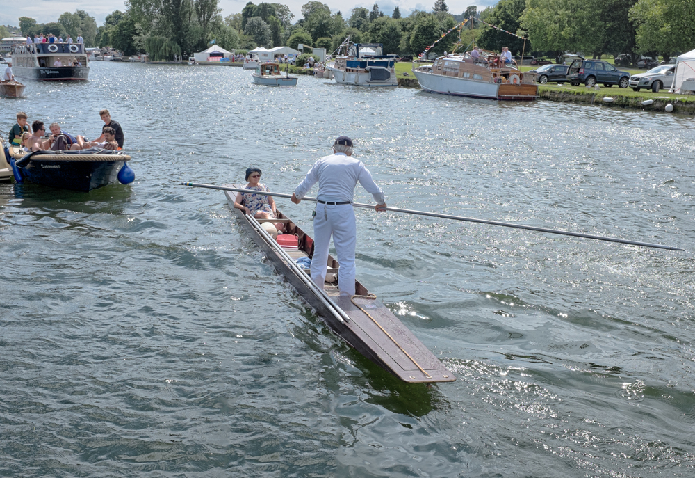 A spectator at Henley Royal Regatta takes to the water in a punt to watch the racing. Rowing boats, cruisers and bargers also plow up and down the 2.5km stretch of the river Thames to watch the events.
