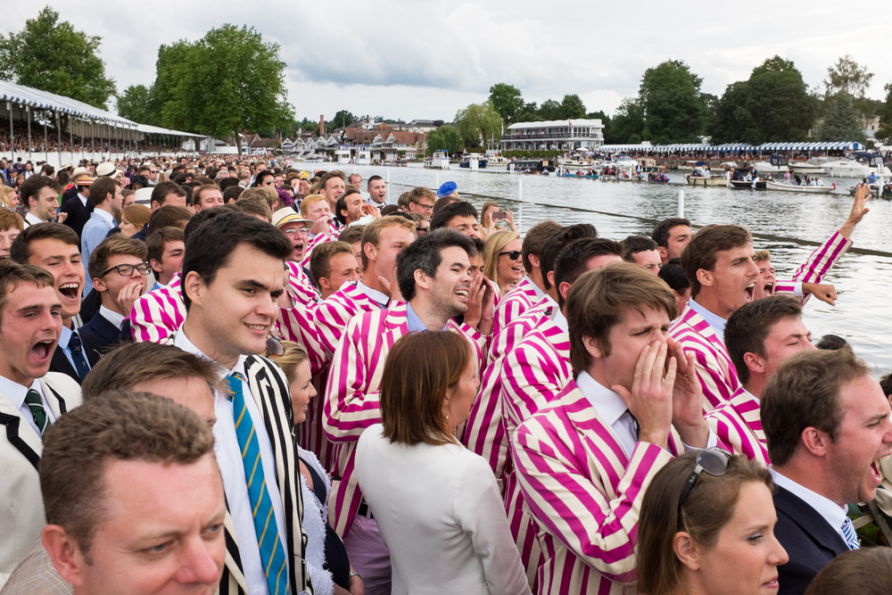Spectators from Abingdon School cheer on their classmates in the Princess Elizabeth Challenge Cup at Henley Royal Regatta.