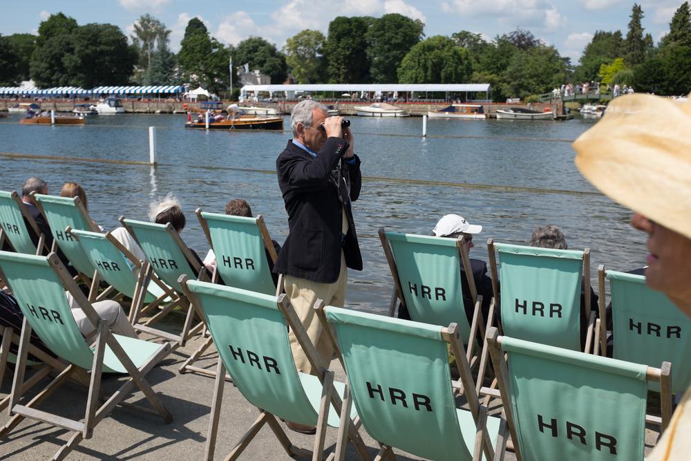 A spectator at Henley Royal Regatta surveys the course.