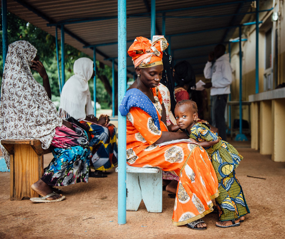 From recent work for the Medical Research Council. A pregnant woman waits with her eldest daughter to see an MRC midwife in Kenya, The Gambia.
