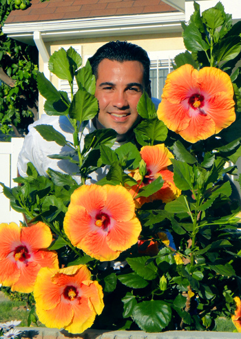 Darren with a young Acapulco Gold plant in 2011.  Yes the blooms are almost as large as my head!
