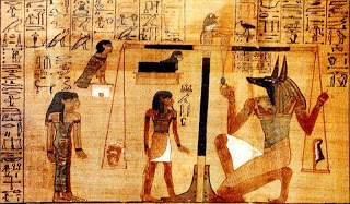 Here is an image of Egyptian Neteru for telling Anubis (The half canine, half man of the afterlife, death) in the Final Judgement weighing the heart of the recently deceased on the scales of balance. Here, there is a feather on the other side representing Ma'at 42 Law of Principle. If the heart is out weighting the feather, the individual has left with a heavy heart (literally) and is carry those same burdens into the next life cycle of reincarnation. If it is balanced the individual has paid off their debts to start fresh. That is the karma.