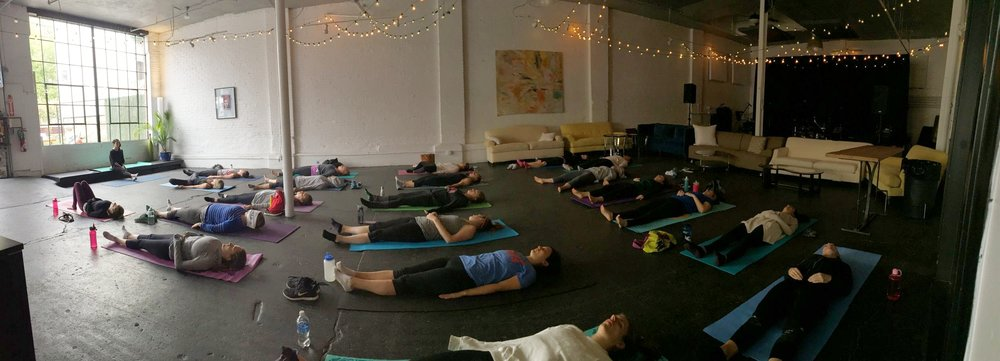 Guiding students through a body scan and breathing exercise at Barre Yoga Juice