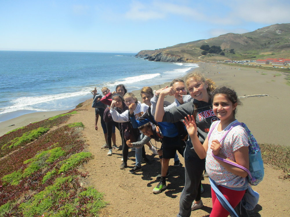 Campers hiking along rodeo beach in soithern marin