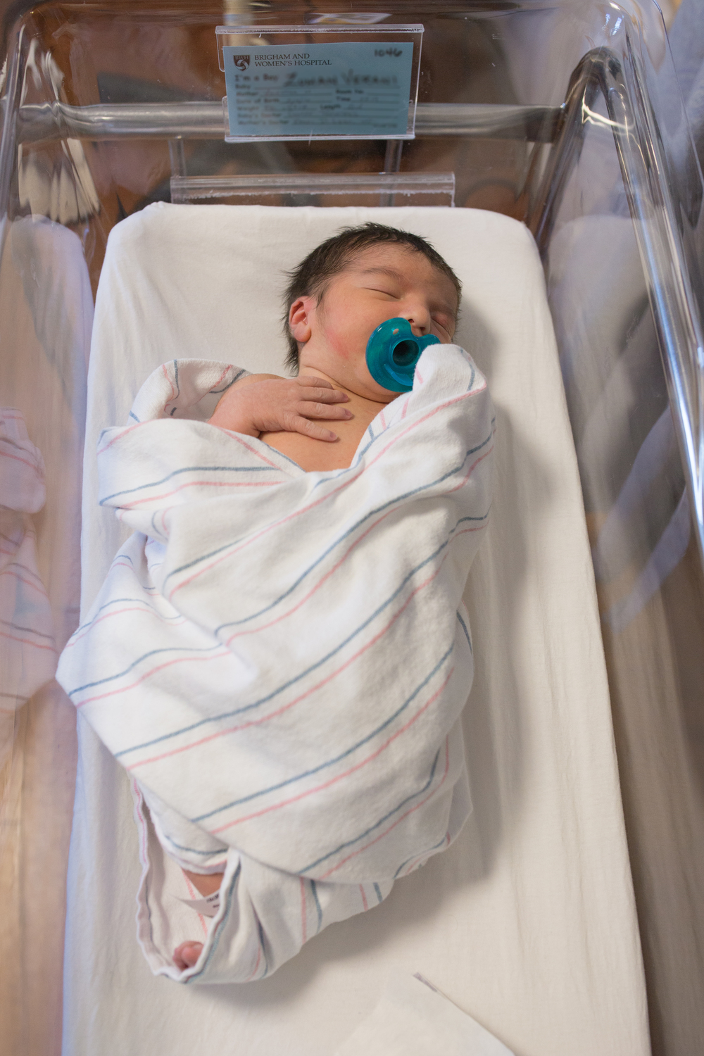 Newborn baby at Brigham and Women's hospital in Boston Massachusetts in bassinet