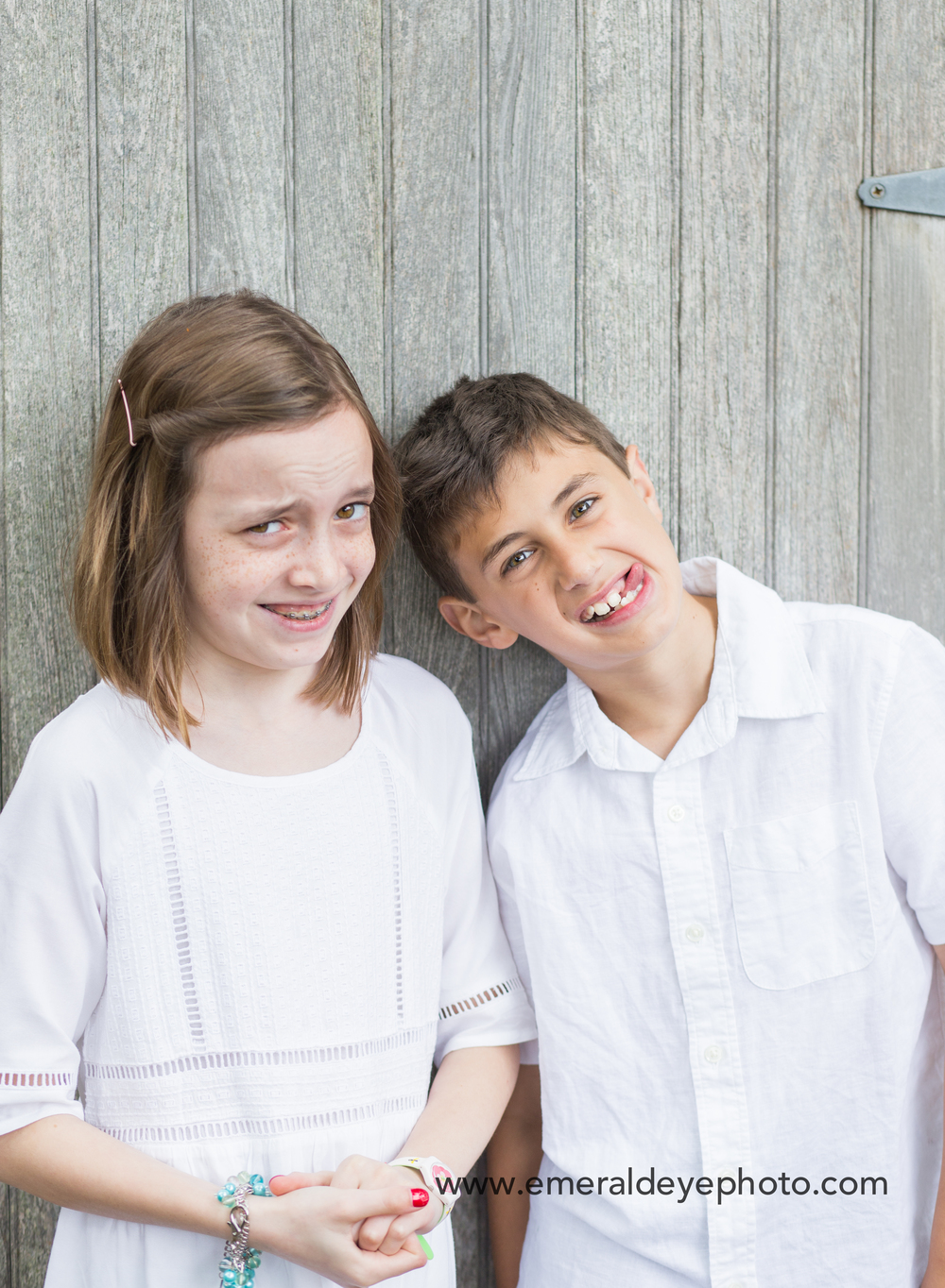 Brother and sister make funny faces during family photos in Massachusetts