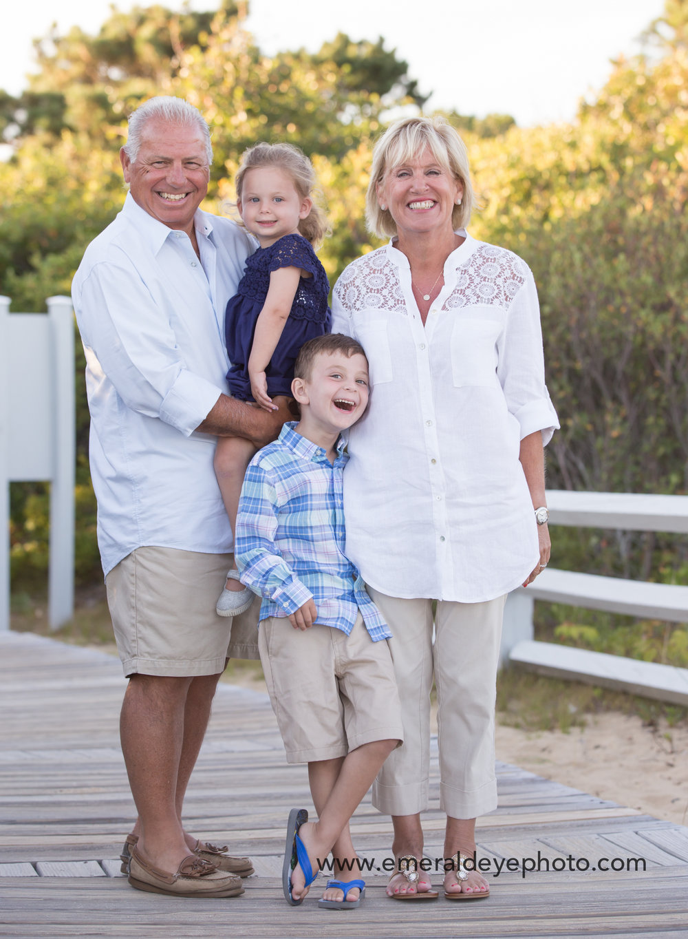 Family laughs on the boardwalk at South Cape Beach in Mashpee Massachusetts