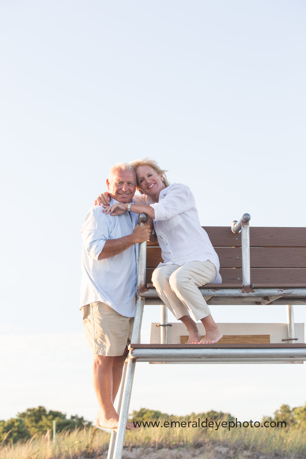 Grandparents in lifeguard stand at South Cape Beach in Mashpee Massachusetts