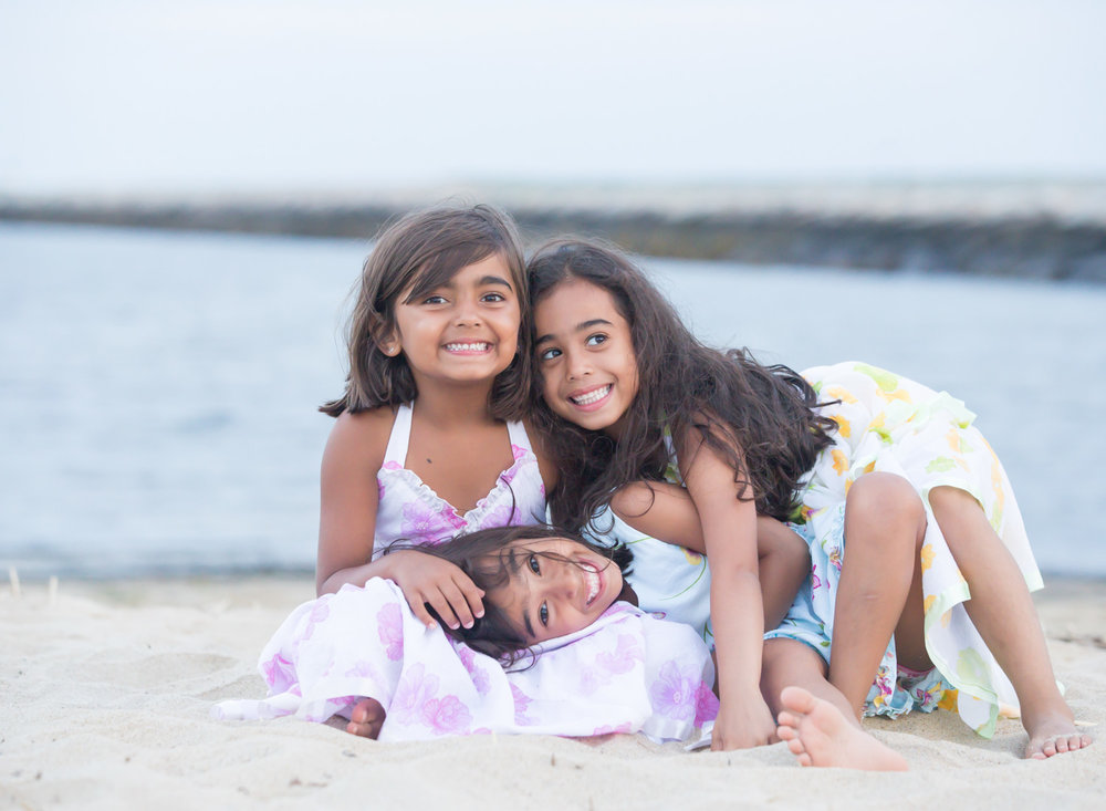 Three sisters having fun on a Cape Cod beach in Provincetown Massachusetts