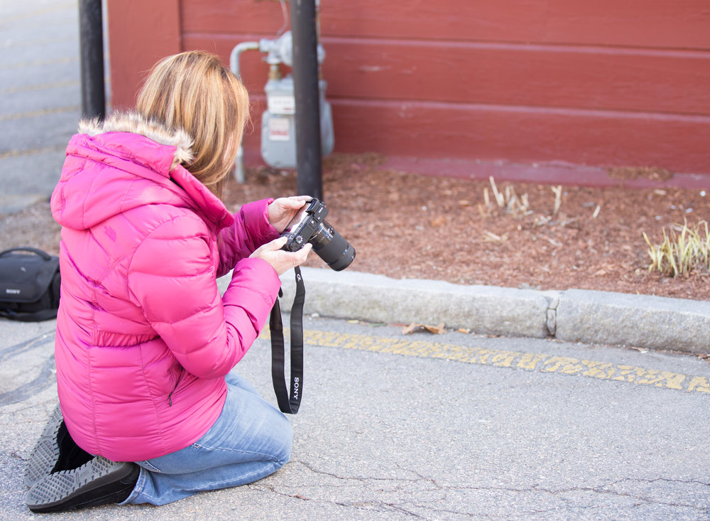 student looking at camera during photography class in Massachusetts