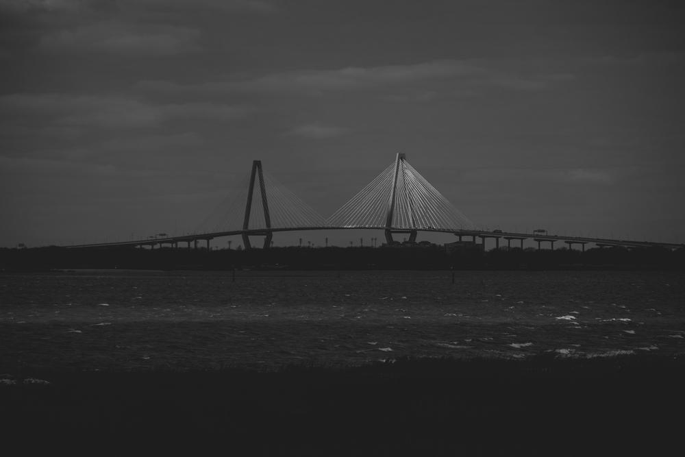 A ray of light sweeps across the Ravenel Bridge in Charleston, SC