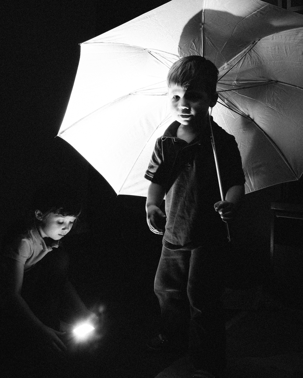 Letting my kids play around a bit with my flash and umbrella.