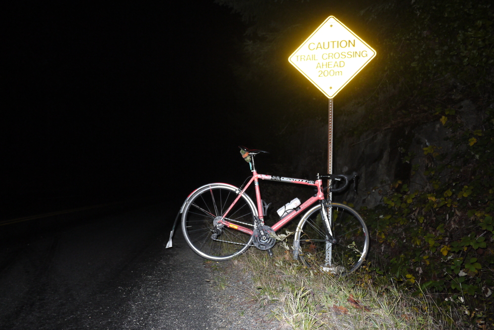 Ride ten minutes up in pitch black, turn light on, ride down.