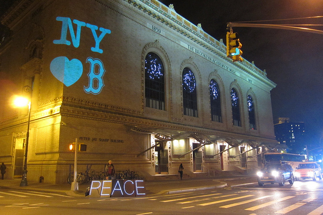 The Illuminator projecting messages of peace on the Brooklyn Academy of Music. Photo by Lucky Tran.