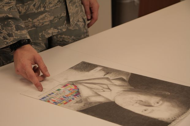 MSgt Covel and his self-portrait. Image via NEA.