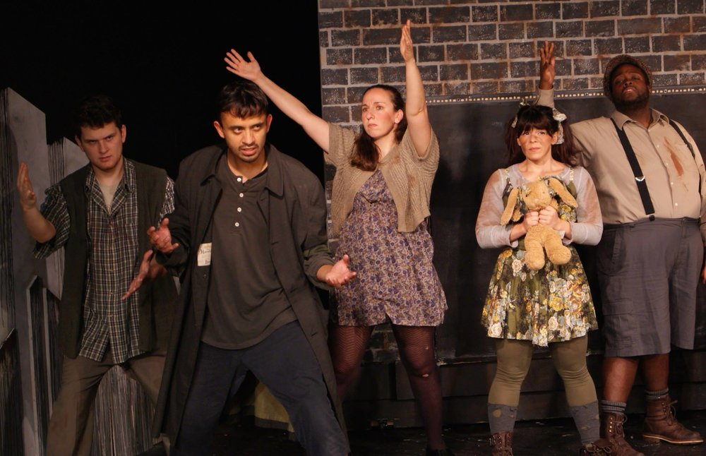 "Playing Robbie The Stockfish in ""Urinetown""."