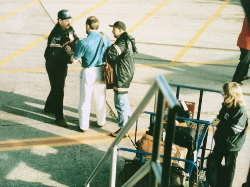 FBI agents arrest CIA officer Jim Nicholson at Dulles International Airport on November 16, 1996. (Credit: FBI)