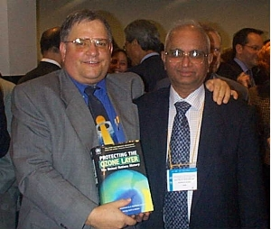 Stephen Andersen (left) and Madhava Sarma at Montreal Protocol meeting 2002 where they launched their book, Protecting the Ozone Layer.