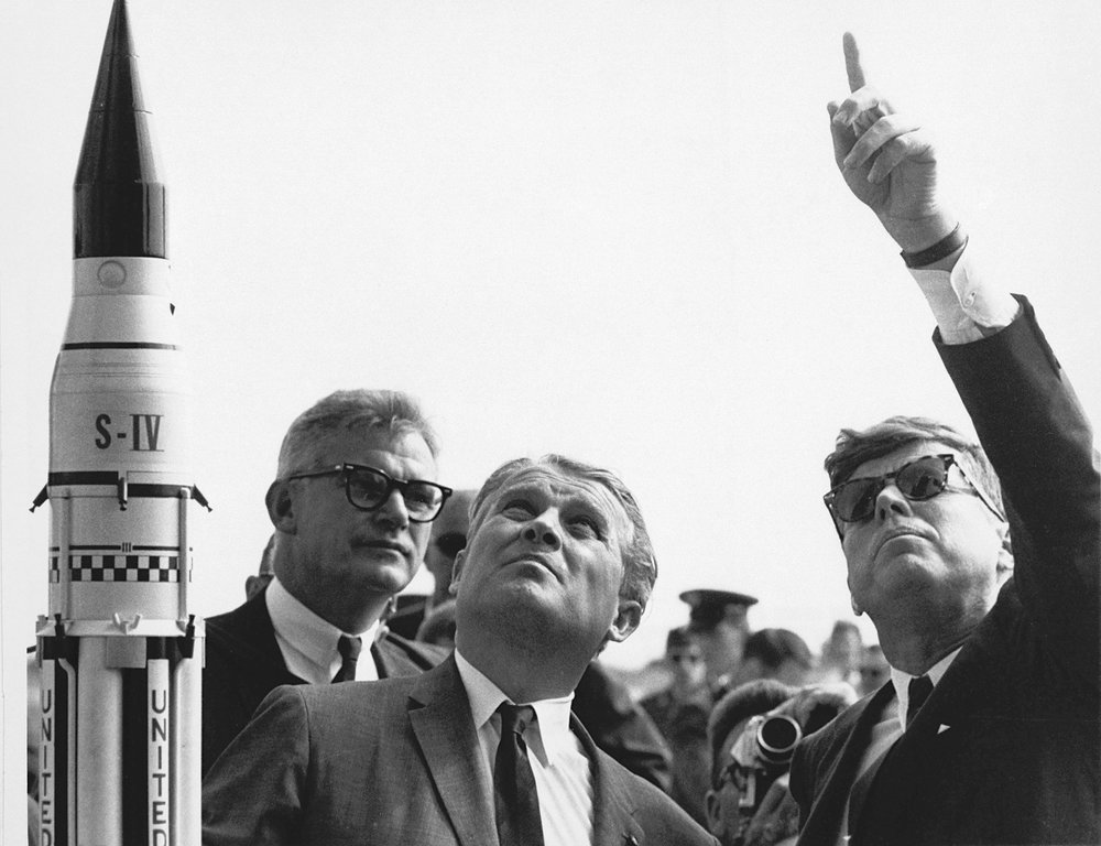 Wernher von Braun with President John F. Kennedy at Cape Canaveral, 1963. NASA's deputy administrator, Robert Seamans is behind von Braun