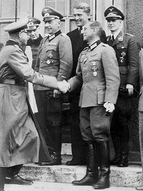 Rocket engineer Wernher von Braun (back row, second from right) and members of his Peenemunde rocket team are congratulated by Gen. Erich Fellgiebel (left), head of the German Army Information Service during WWII, for a successful V-2 rocket test in October 1942.