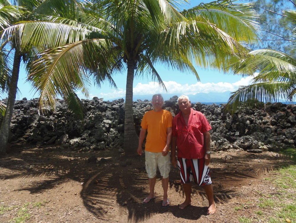 Jeff Sissons and local leader Ato Fogier standing in front of a ruined Marae in Moorea.
